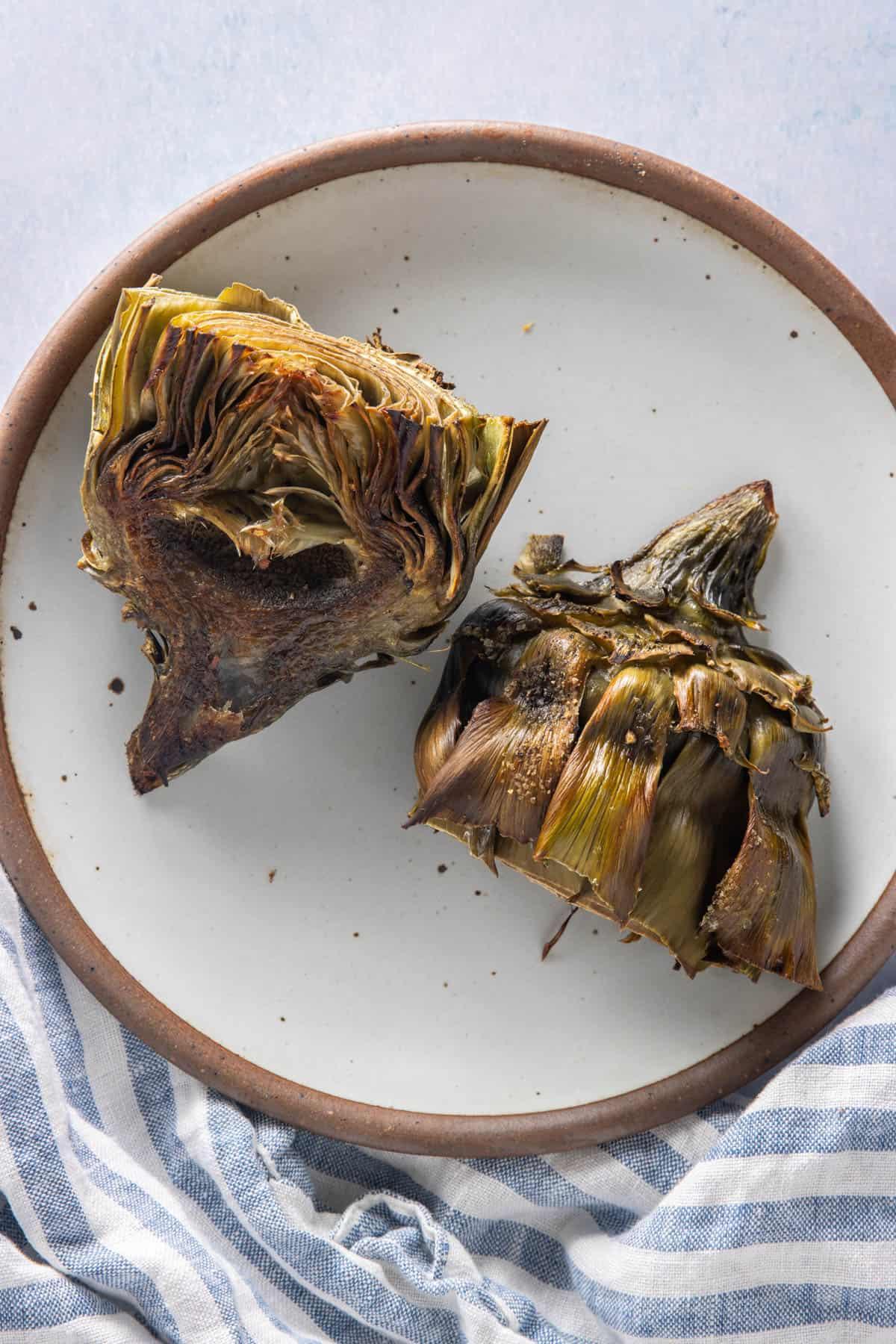 Air fried artichokes on a plate