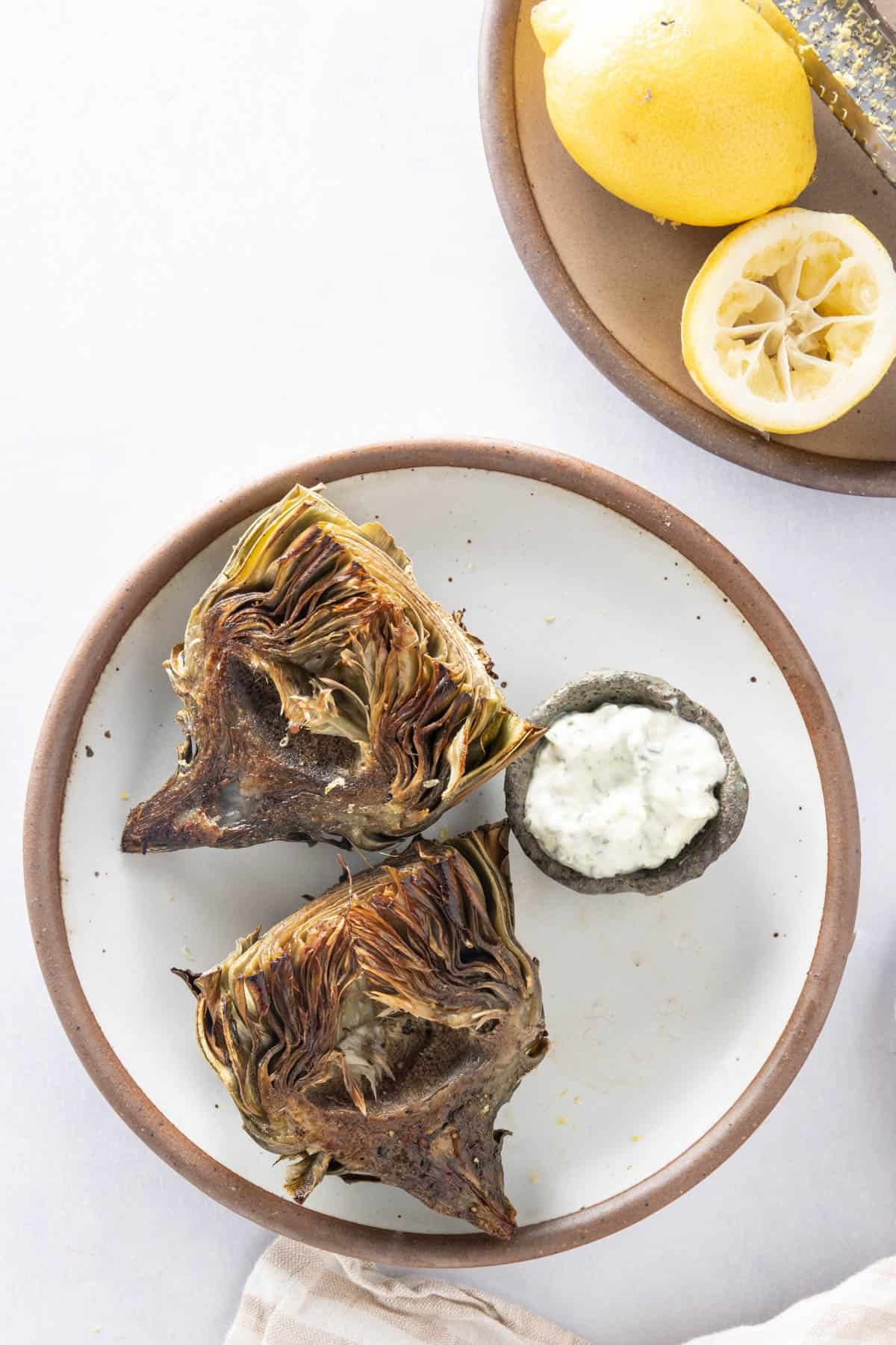 Plate of air fryer artichokes with basil aioli