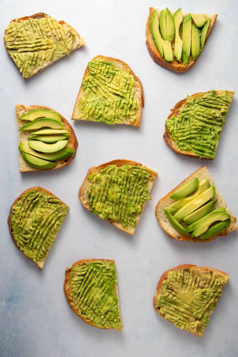 Several avocado toasts on a table