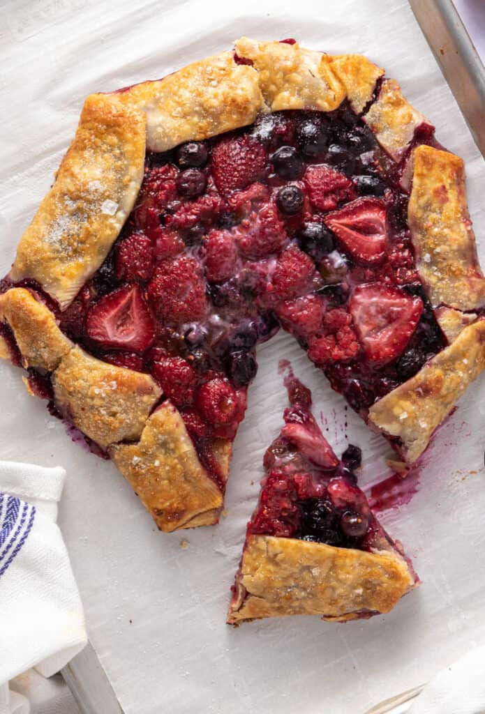 Slice of berry galette removed from the main pie