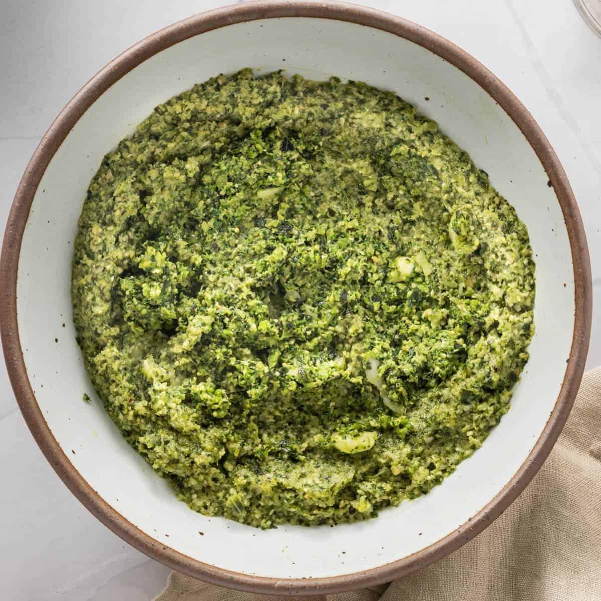 Close up of broccoli pesto in a bowl