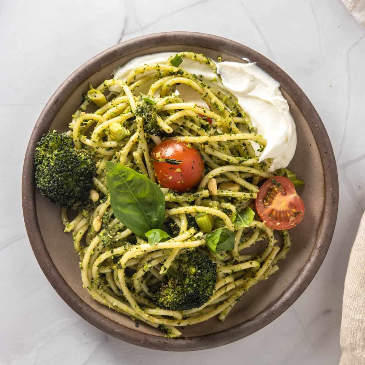 Broccoli pesto pasta with cherry tomatoes and whipped ricotta