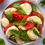 Plate with caprese salad in the center