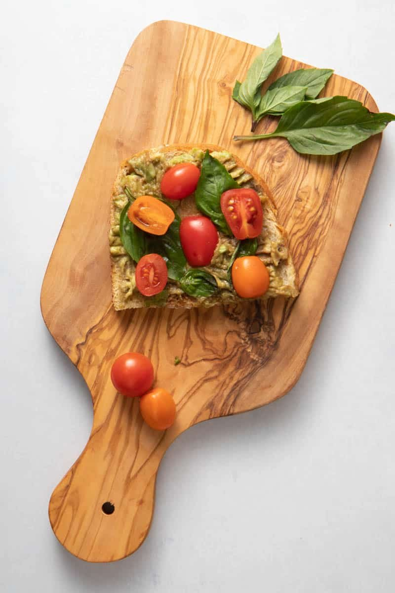 Caprese avocado toast with cherry tomatoes, basil and balsamic