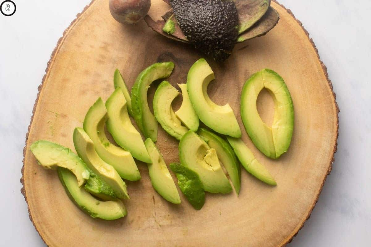 Sliced avocados on a platter to show thickness