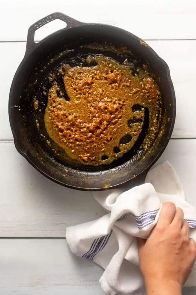 As you temper the olive oil with spices, it will turn a golden brown and bubble