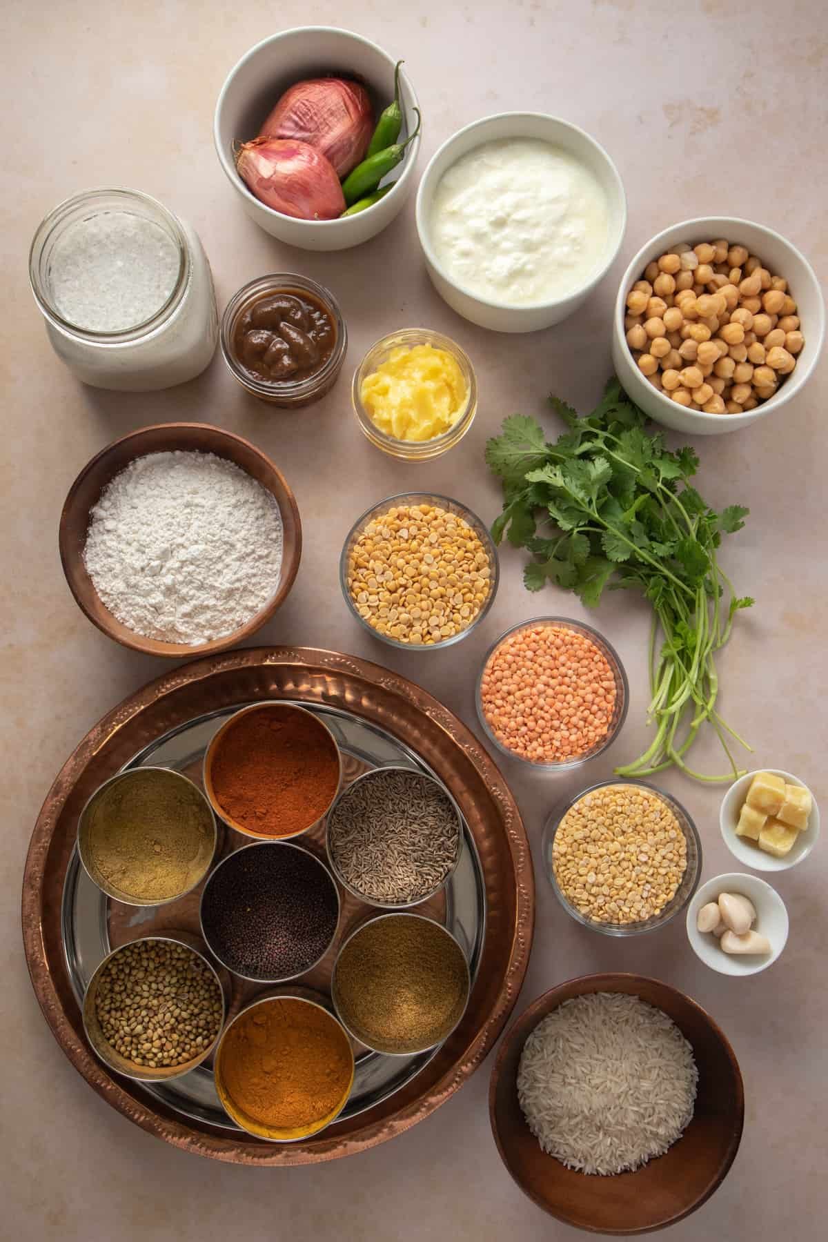 Array of all Indian pantry essentials required - spices and ingredients, details in the post