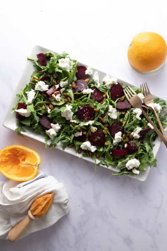 Platter with roasted beets, arugula, goat cheese and pistachios