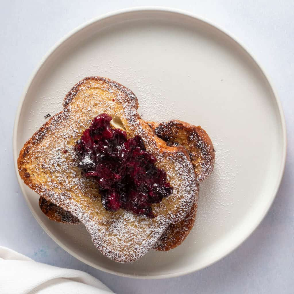 Close up of French toast on plate with berry compote