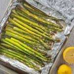 Close up of grilled asparagus in foil packets