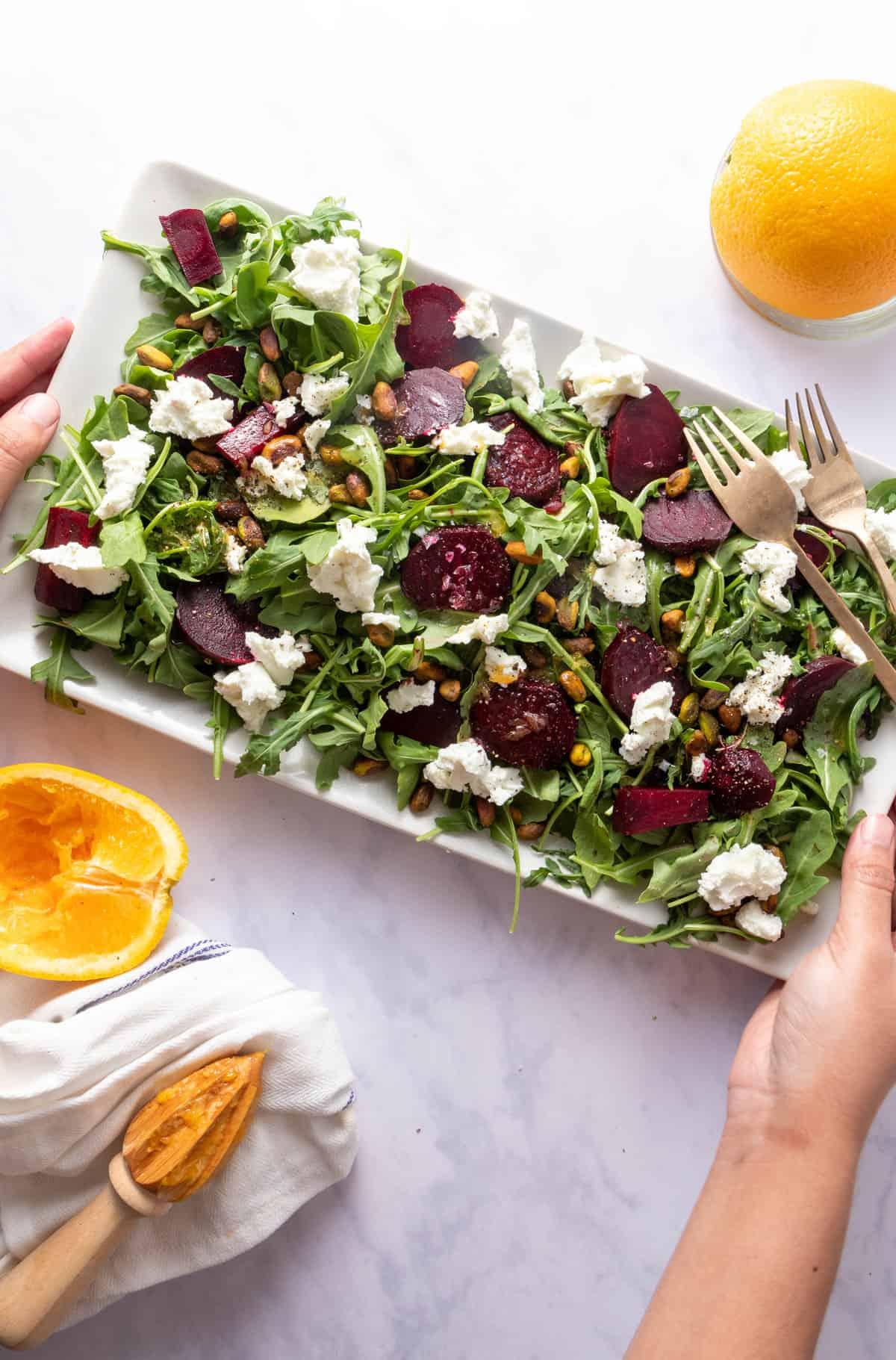 Serving a platter of the finished salad