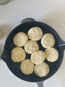 Arrange the biscuits into a cast iron skillet