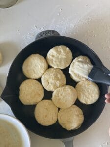 Brush butter on the biscuits in the skillet