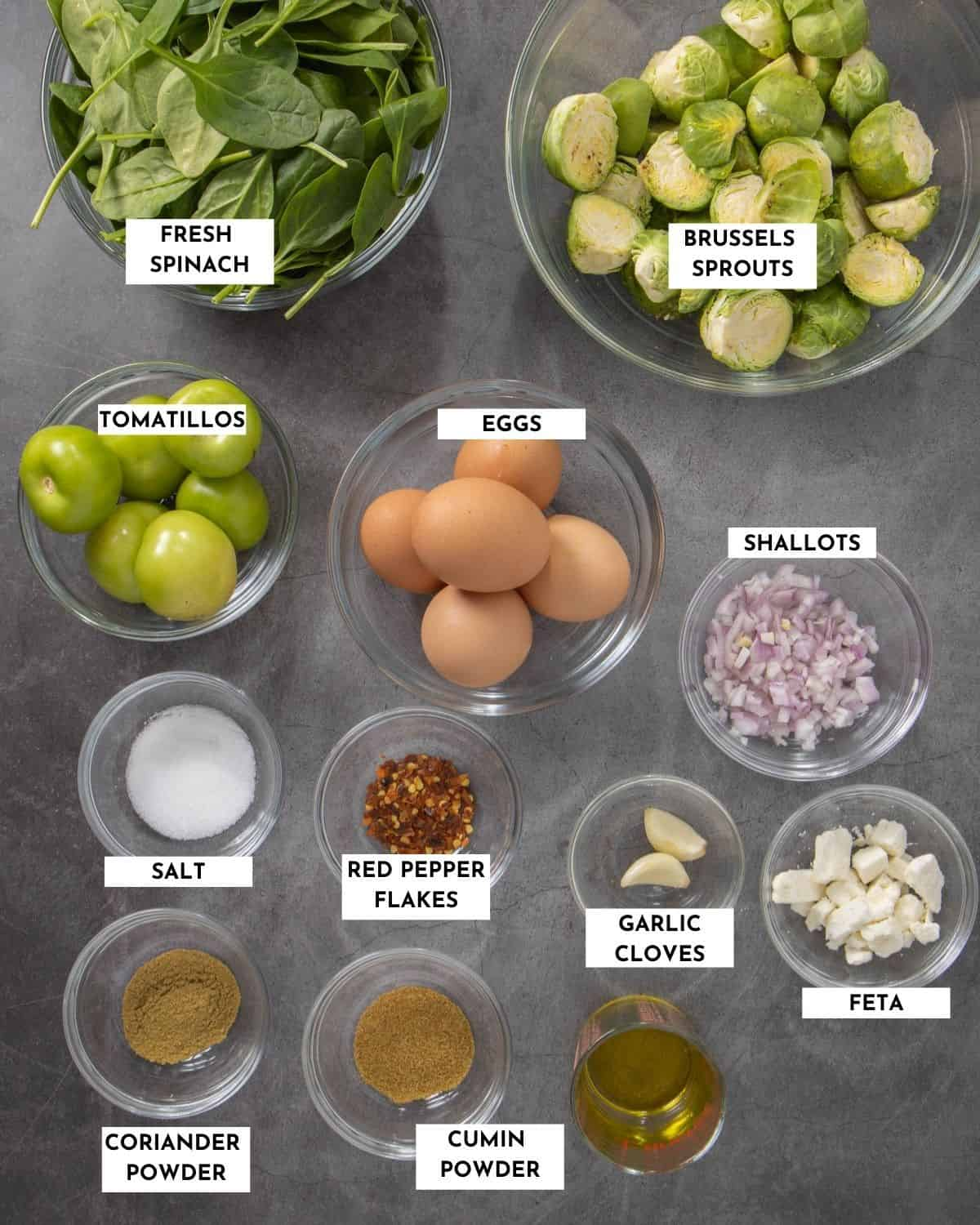 Labeled ingredients for green shakshuka - check recipe card for details and specifics!