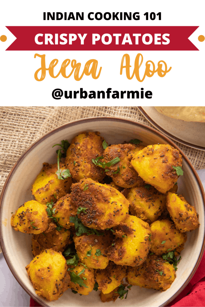 Pinterest graphic showing a picture of finished Jeera Aloo