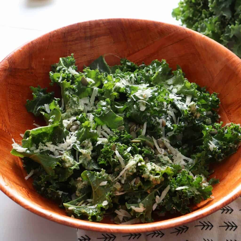 Bowl of hearty kale salad with green goddess dressing