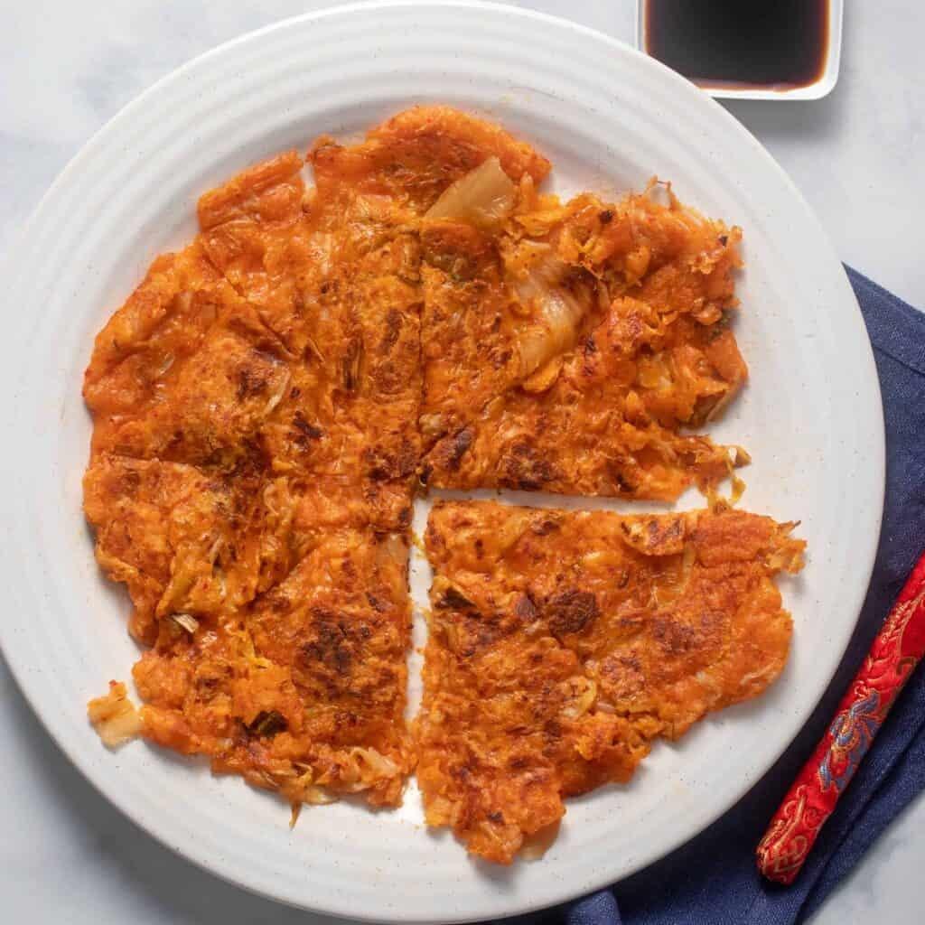 Sliced kimchi pancake showing crispy edges