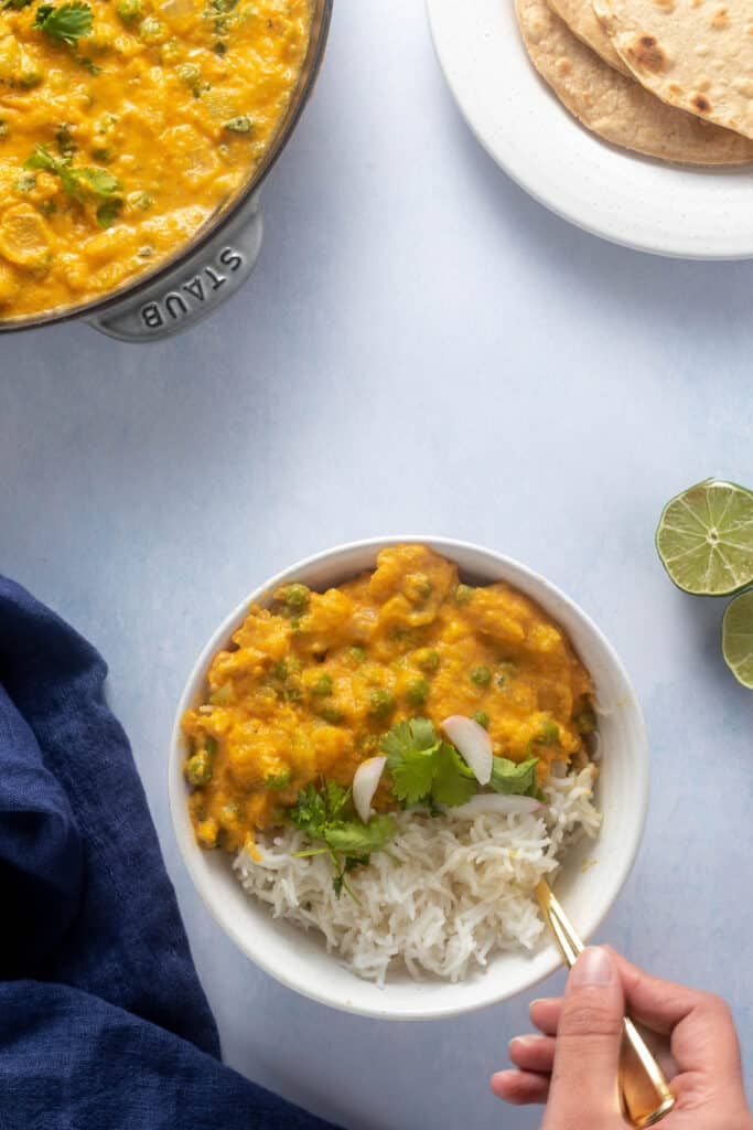 Korma bowl with a spoon in it