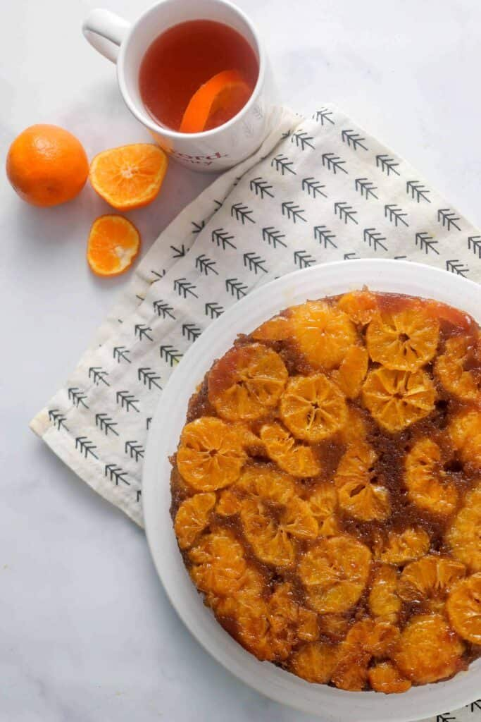 Mandarin cake with a glass of orange tea