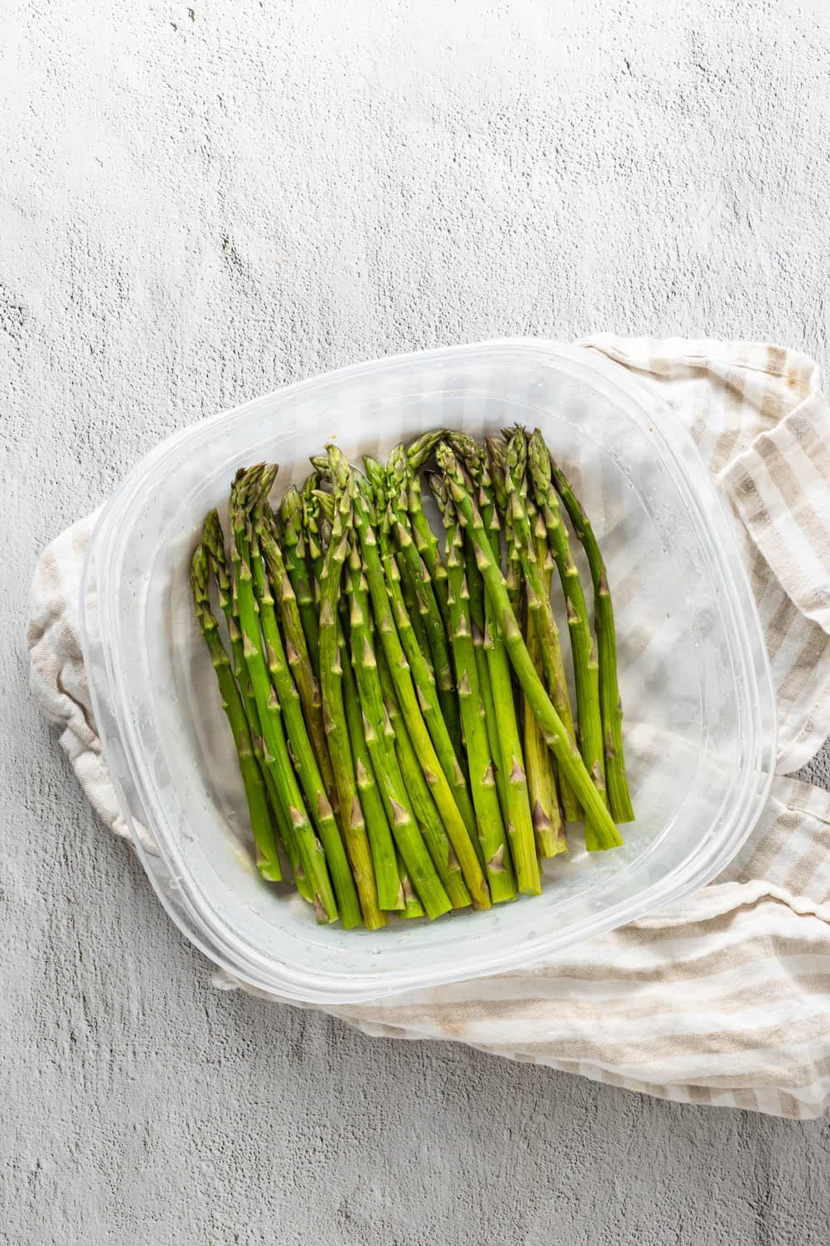 Asparagus in microwave safe container after being steamed
