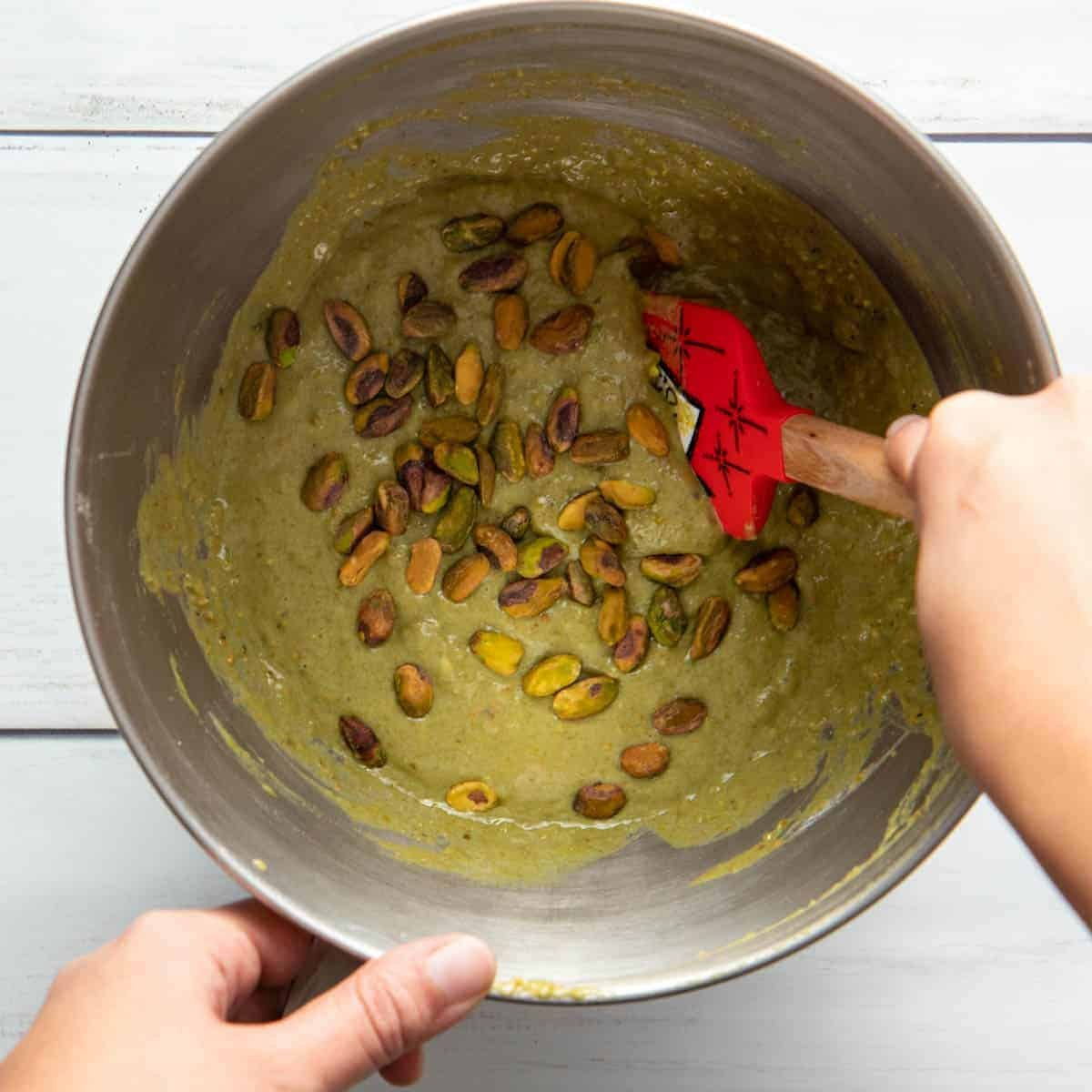 Pistachio muffin batter should be fluid and not overmixed