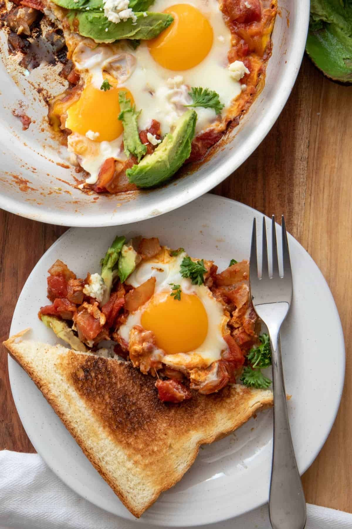 Plate of Moroccan Shakshuka with perfect runny yolks