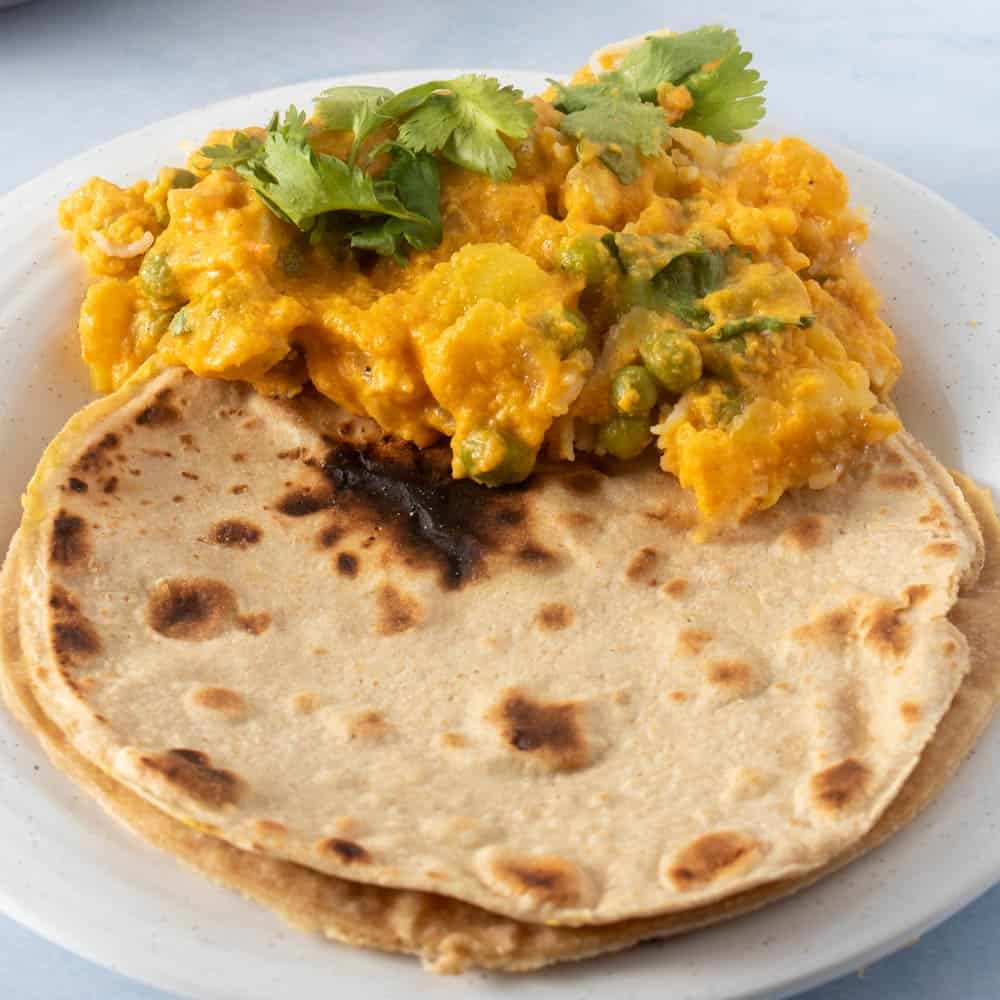 Roti with vegetable korma on a plate