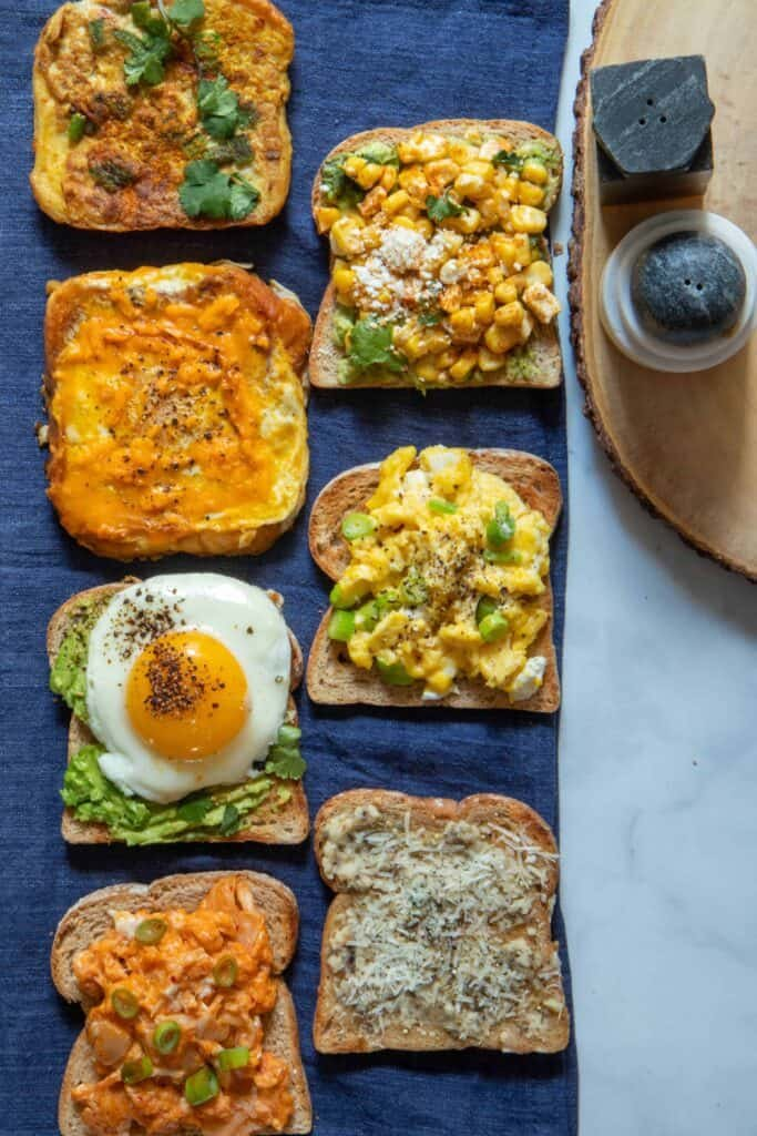 Savory toasts from around the world - basic avocado toast with perfect fried egg, scrambled eggs with goat cheese on toast, mexican street corn toast, Korean kimchi toast