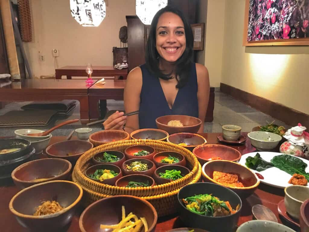 Shruthi with Korean banchan in front of her