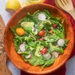 Close up crop of spinach avocado salad
