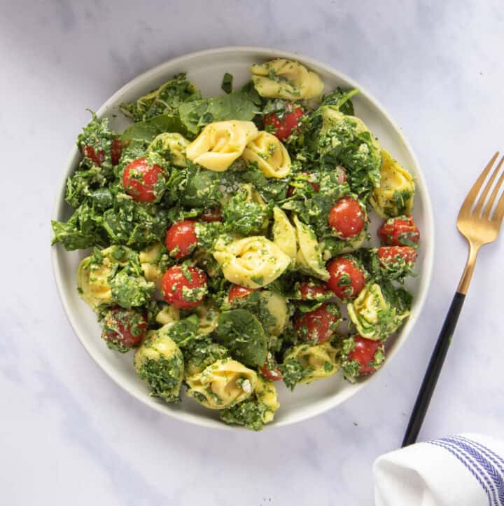 Close up of plate of spinach tortellini salad
