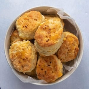 Bowl of freshly baked cheddar skillet biscuits