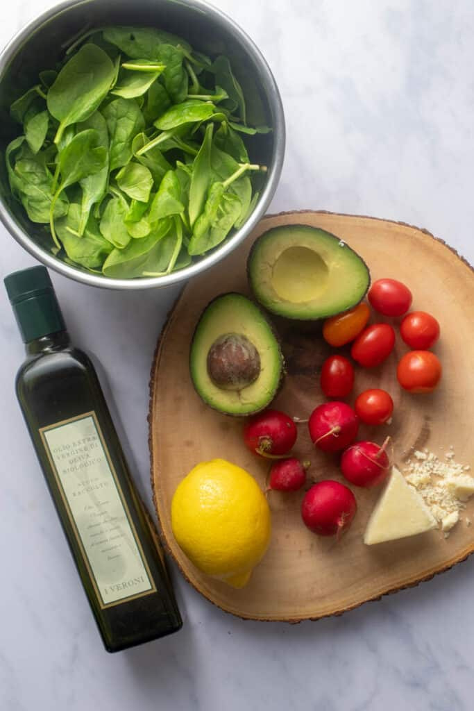 Ingredients needed for simple spinach and avocado salad
