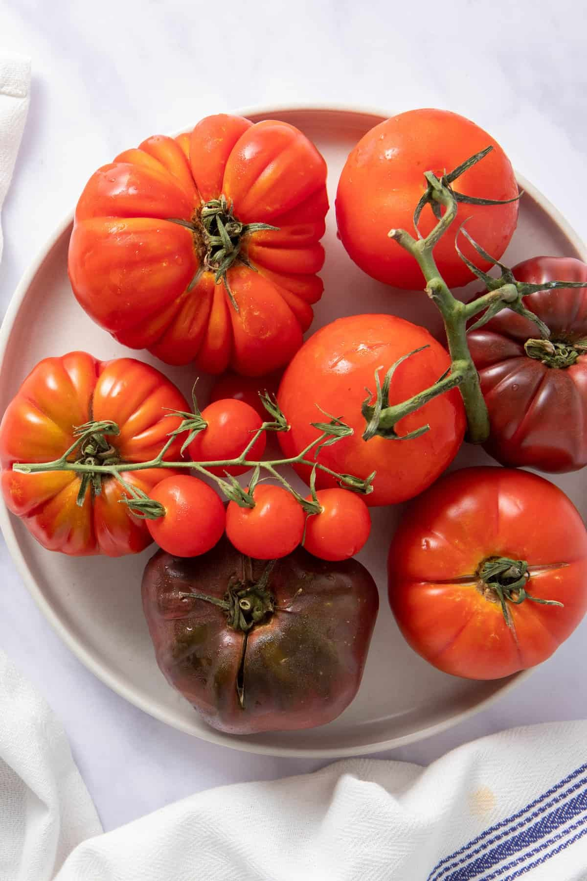 Plate of different types of tomatoes used in the salad