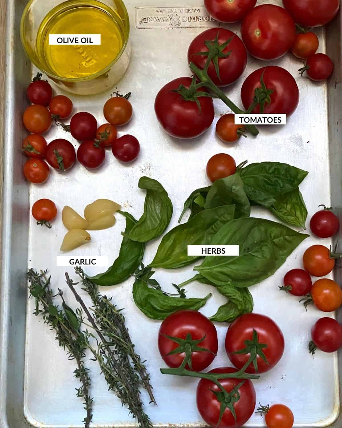 Labeled ingredient image showing what's needed to make tomato confit - check recipe card for details!