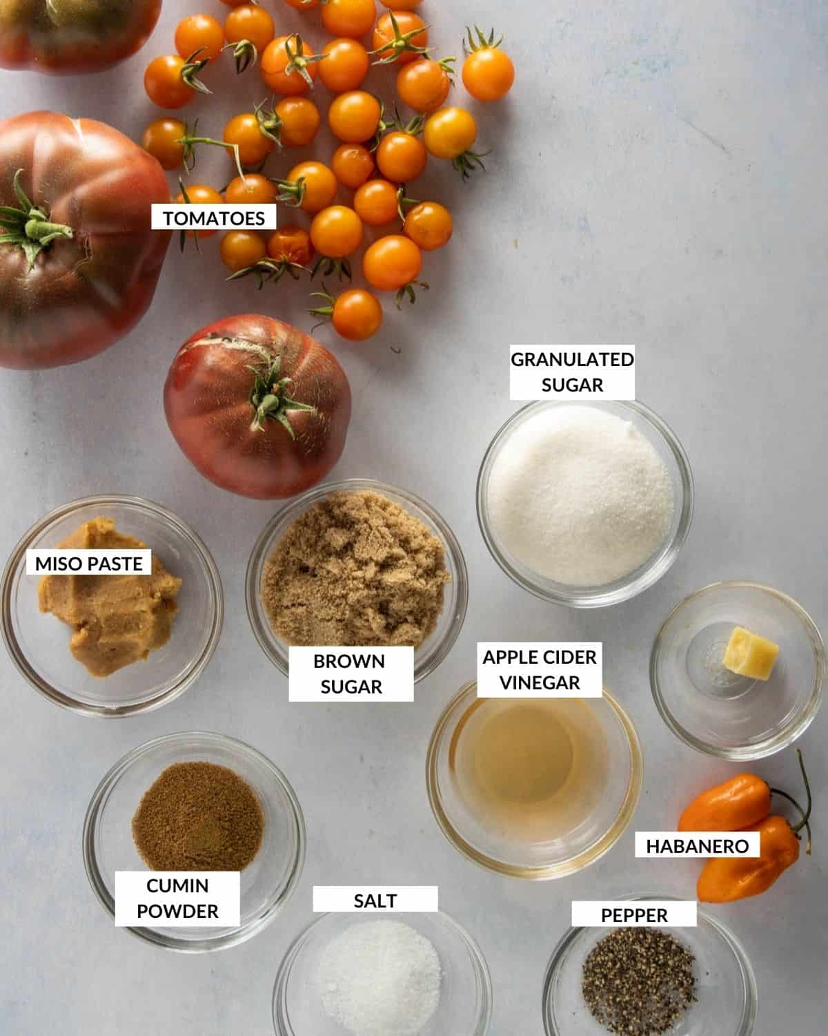 Labeled ingredient list for making tomato jam - check recipe card for details!